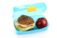 Lunch box. Box with lunch - delicious sandwich and fruit on white Royalty Free Stock Photography