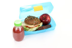 Lunch box. Box with lunch - delicious sandwich fruit and juice on white Royalty Free Stock Images