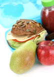 Lunch box. Box with lunch - delicious sandwich and fruits close-ups Stock Photography