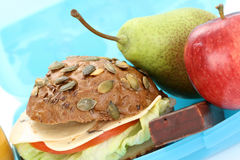 Lunch box. Box with lunch - delicious sandwich and fruits close-ups Royalty Free Stock Photos