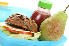 Lunch box. Box with lunch - delicious sandwich and fruit close-ups Stock Photography