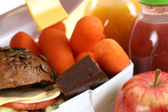 Lunch box. Box with sandwich fruits and chocolate and bottle of juice Stock Photos