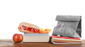 Lunch box with appetizing food and bag. On table against white background royalty free stock photography