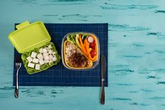 Lunch box with appetizing food and on light wooden table. Copy space. Lunch box with appetizing food and on light wooden table royalty free stock image