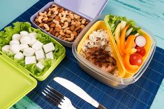 Lunch box with appetizing food and on light wooden table.  stock photos