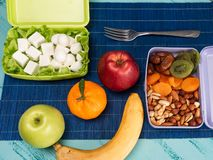 Lunch box with appetizing food and on light wooden table.  stock image