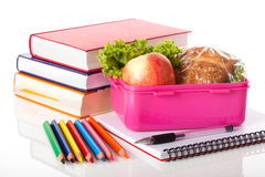 Lunch box and books Stock Photos