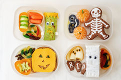 Lunch box for children in the form of monsters Stock Photos