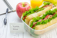 Lunch box with ciabatta bread sandwiches, apple and orange juice Royalty Free Stock Photos