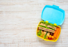 Lunch Box with Food and Copy Space. Colored Lunch Box with Sandwiches and Fresh Vegetables on Copy Space Text Area stock images