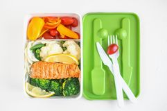 Lunch box with food on wooden background, top view royalty free stock photography