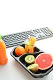 Lunch box healthy fruits and vegetables. Healthy food for work. Stock Image