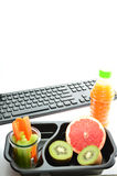 Lunch box healthy fruits and vegetables. Healthy food for work. Stock Photography