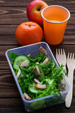 Lunch box with salad, apple, tangerine and juice. Stock Images