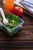 Lunch box with salad, apple, tangerine and juice. Royalty Free Stock Photos