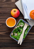 Lunch box with salad, apple, tangerine and juice. Royalty Free Stock Image