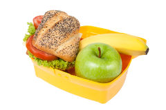 Lunch box with sandwich, apple banana Stock Images