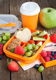 Lunch box with sandwich, cookies, veggies and fruits. Lunch box for kids with sandwich, cookies, fresh veggies and fruits Royalty Free Stock Photos