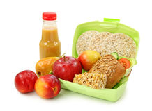 Lunch box with sandwich and fruits stock photography