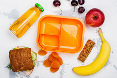 Lunch box, sandwich and fruits. Back to School concept. Flat lay style Stock Image
