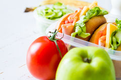 Lunch box with sandwich salad and friuts Stock Images