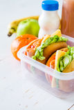 Lunch box with sandwich salad and friuts Royalty Free Stock Photo