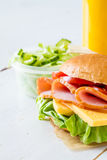 Lunch box with sandwich salad and friuts Stock Photos