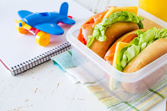 Lunch box with sandwich salad and friuts Stock Photo