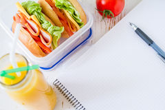 Lunch box with sandwich salad and friuts Royalty Free Stock Images