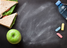 Lunch box. With sandwich and vegetables. Kids take away food box. Top view on blackboard with space for your text stock images