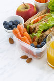 Lunch box with sandwich of wholemeal bread on white table. Vertical, closeup Royalty Free Stock Photos