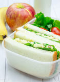 Lunch box with sandwiches, apple, banana and milk Royalty Free Stock Photography