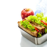 Lunch box with sandwiches and fruits Royalty Free Stock Photos