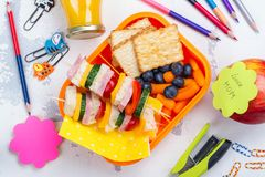 Lunch box and school supplies stock photos