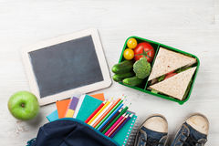 Lunch box and school supplies Royalty Free Stock Images