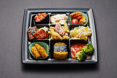 Lunch box with sushi and rolls Royalty Free Stock Photography