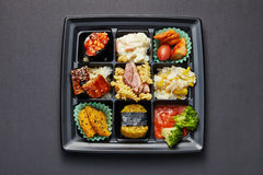 Lunch box with sushi and rolls Royalty Free Stock Photos