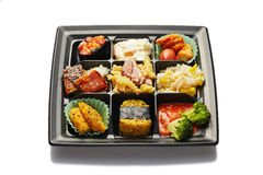 Lunch box with sushi and rolls Royalty Free Stock Photo
