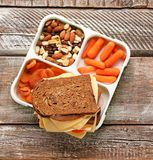 Lunch box with tasty food. On wooden background stock photos