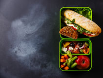 Lunch box with Tuna Sandwich and Greek salad Stock Photography