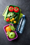 Lunch box. With vegetables, fruits and water bottle. Kids take away food box. Top view royalty free stock photography