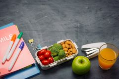 Lunch box with vegetables for a healthy school lunch on wooden t Royalty Free Stock Photos