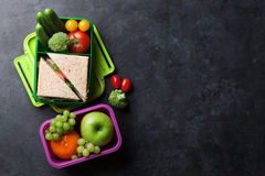 Lunch box. With vegetables and sandwich. Kids take away food box and fruits. Top view on blackboard with space for your text stock image
