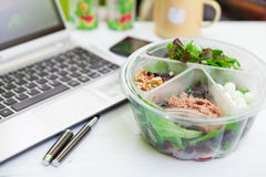 Lunch box on working Stock Image