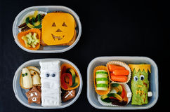 Lunch boxes for children in the form of monsters for Halloween Royalty Free Stock Images