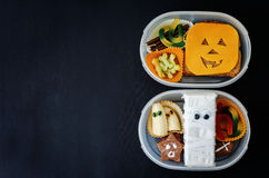 Lunch boxes for children in the form of monsters Royalty Free Stock Photography