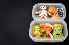 Lunch boxes for children in the form of monsters Stock Photo