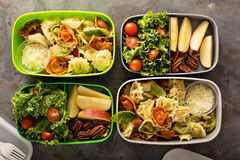 Lunch boxes with food ready to go. For work or school, ahead meal preparation or dieting concept royalty free stock image
