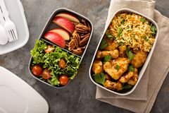 Lunch boxes with food ready to go. For work or school, ahead meal preparation or dieting concept royalty free stock images