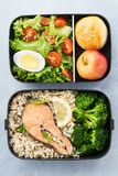 Lunch boxes with food ready to go for work or school. Meal preparation or dieting concept royalty free stock photos
